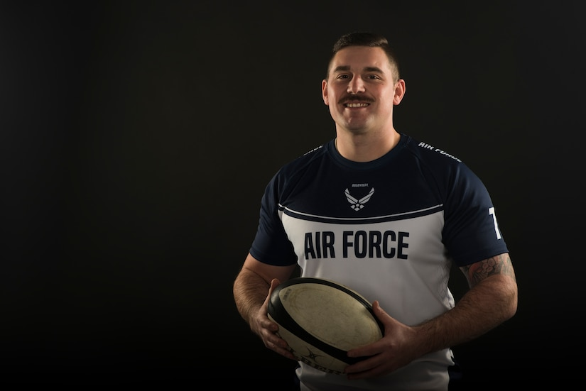 Staff Sgt. Drake Dougherty, an inbound cargo supervisor assigned to the 437th Aerial Port Squadron, poses for a photo with his rugby ball Jan. 22, 2020, at Joint Base Charleston, S.C. Dougherty has been playing on the Air Force rugby team for one year, but has been playing rugby for 11 years total. The Air Force rugby team helped Dougherty when he was going through a challenging time in his life by promoting positive thinking, teamwork and finding motivation.  Dougherty also plays for a local rugby team called the Charleston Outlaws