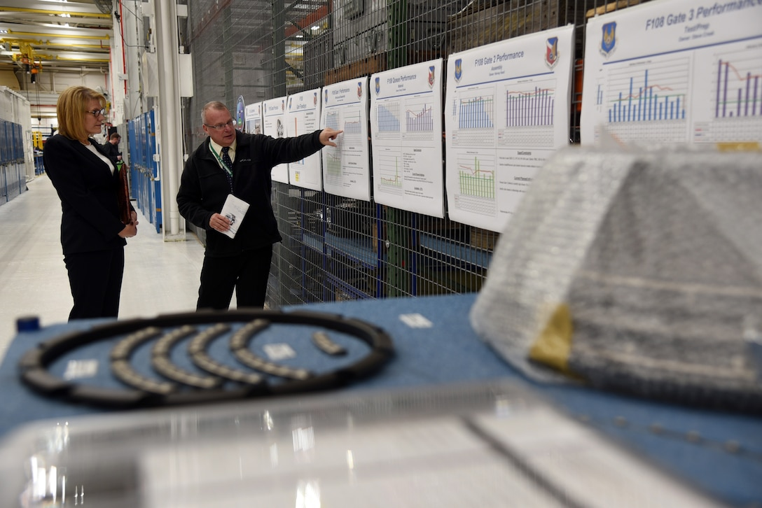 John Wood, 546th Propulsion Maintenance Group civilian lead, provided an overview of the F108 Production Machine during an immersion tour of the Oklahoma City Air Logistics Complex for Angela Tymofichuk, deputy assistant Secretary of the Air Force for logistics and support. Tymofichuk visited Tinker Dec. 16-19, meeting with members of Team Tinker who highlighted their areas, focusing on growth opportunities and future strategies for success. (U.S. Air Force photo/Kelly White)