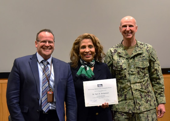Naval Surface Warfare Center, Philadelphia Division (NSWCPD) Commanding Officer Capt. Dana Simon (right) and Technical Director Tom Perotti (left) presented Dr. Terri A. Dickerson, Director, Civil Rights Directorate, U.S. Coast Guard, with a certificate of appreciation following her remarks at NSWCPD's Dr. Martin Luther King Jr. Birthday Observance on Jan. 22. Dickerson shared her story from being a member of the first class to integrate the New Orleans Catholic school system to a member of the Senior Executive Service (SES). (U.S. Navy Photo by Kirsten. St. Peter/Released)