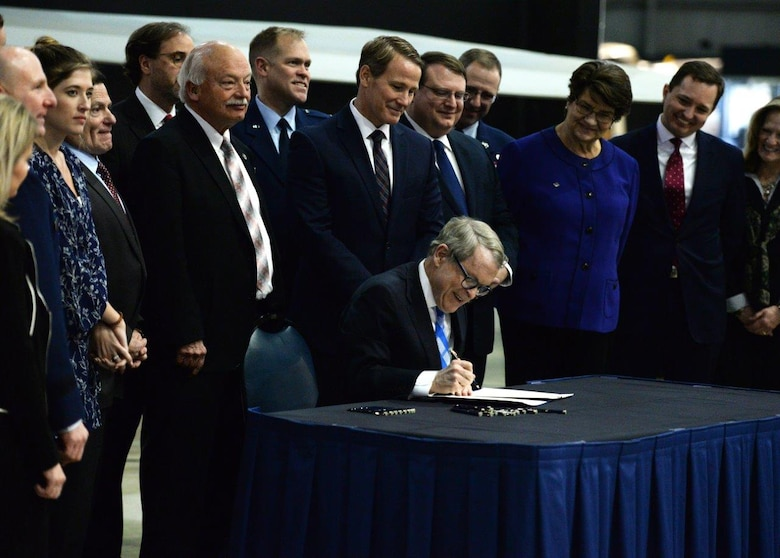 Ohio Governor Mike DeWine signs Senate Bill 7 into law at the National Museum of the United States Air Force, Wright-Patterson Air Force Base, Ohio, Jan. 27, 2020. The bill mandates Ohio agencies to issue licenses or certificates to qualifying military members and their spouses. (U.S. Air Force photo by Wesley Farnsworth)