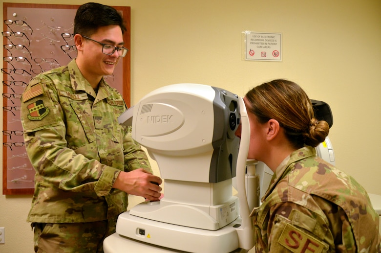 Senior Airman Christopher Miracle, 9th Aerospace Medicine Squadron optometry technician, pre-screens a patient prior to an eye examination Jan. 23, 2020 at Beale Air Force Base, California. (Courtesy U.S. Air Force photo by Capt. Jenell Brown)