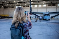 Nicola Macaulay, a professor at Massey University, Palmerston North, New Zealand, takes a picture of an MV-22B Osprey with Marine Medium Tiltrotor Squadron (VMM) 363 during a tour of Marine Corps Base Hawaii (MCBH), Dec. 11, 2019. New Zealand professors toured MCBH to learn about the Hawaii Marine Air-Ground Task Force and the base's mission in the U.S. Indo-Pacific region. The tour included a static display of amphibious assault vehicles, MV-22B Ospreys with VMM-363, and a flight simulation of an Osprey. (U.S. Marine Corps photo by Cpl. Matthew Kirk)