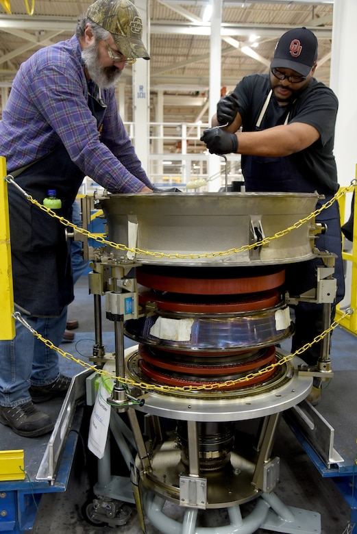 Gary Beach and Thymes Givings work on disassembling an F119 intermediate case.
