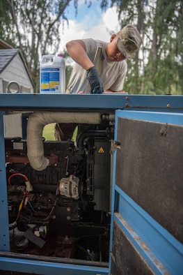U.S. Air Force Staff Sgt. Gabriel Carias, 624th Civil Engineer Squadron electrical power production craftsman, prepares to put antifreeze into an electrical generator at Bellows Air Force Station, Hawaii, Jan. 25, 2020.