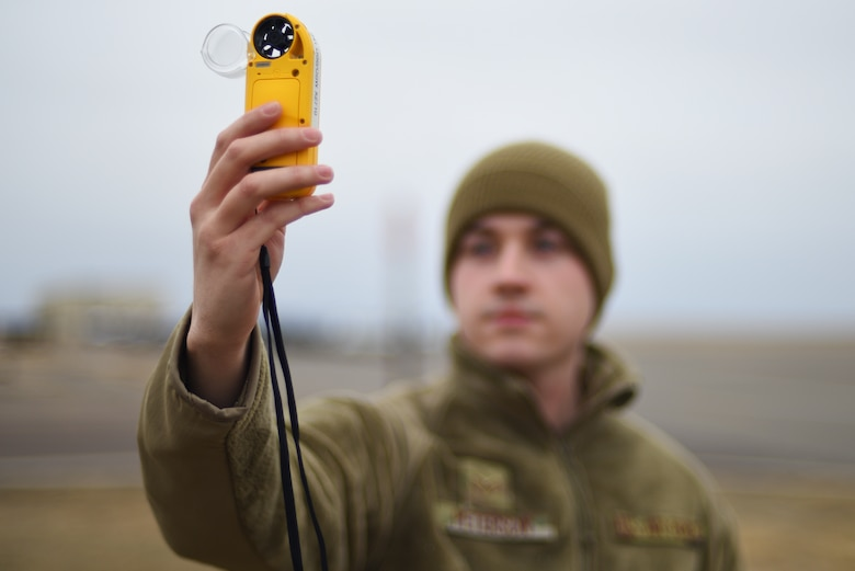 Senior Airman Corbyn Peterson, 341st Operational Support Squadron weather forecaster, uses a Kestrel to make weather observations Jan. 9, 2020, at Malmstrom Air Force Base, Mont.