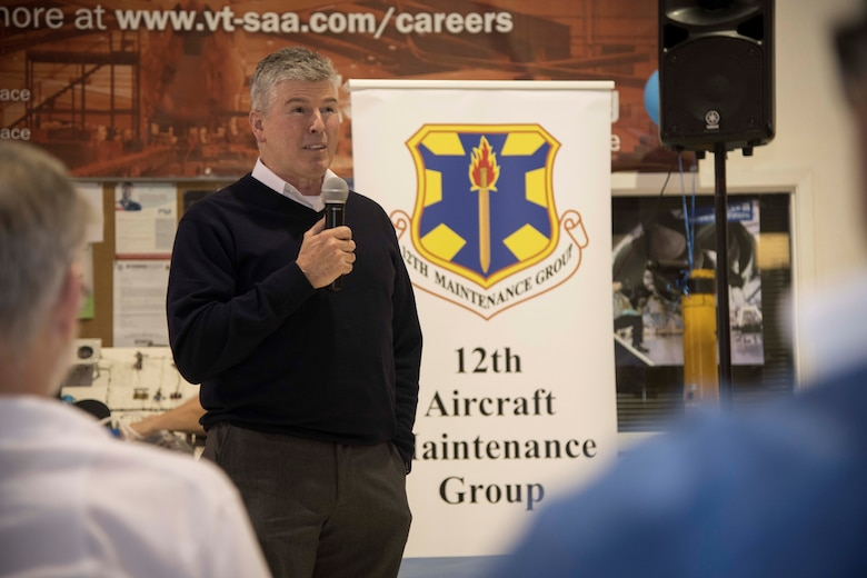 Robert J. West, 12th Maintenance Group director of maintenance, discusses the 12th MXG mission and welcomes the group's seven new hires at the Hallmark University College of Aeronautics graduation ceremony Jan. 23, 2020. These hires were a direct result of the 12th MXG's push for recruitment and new employees for the upcoming missions slated for JBSA-Randolph.