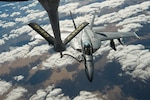 A U.S. Navy F/A-18 Super Hornet receives fuel from a KC-135 Stratotanker assigned to the 28th Expeditionary Air Refueling Squadron over Afghanistan, Jan. 14, 2020.
