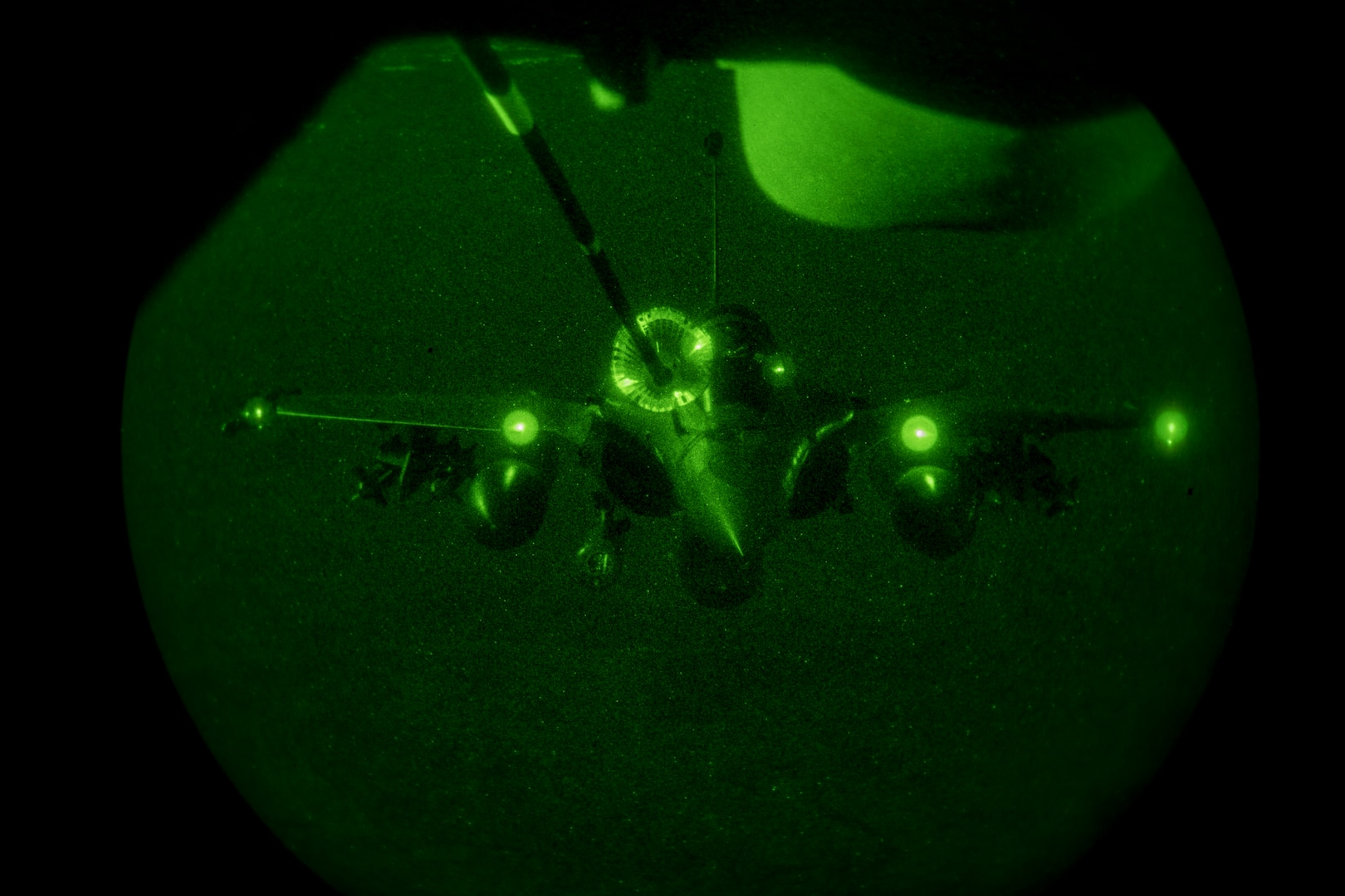 A U.S. Air Force KC-10 Extender boom operator with the 908th Expeditionary Air Refueling Squadron conducts an aerial refueling with a French Air Force Dassault Rafale fighter aircraft in support of Operation Inherent Resolve, Jan. 11, 2020.