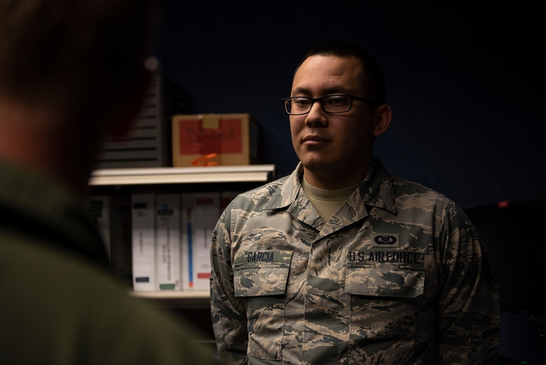 U.S. Air Force Senior Airman Alan Garcia, 325th Fighter Wing Tyndall Command Center junior emergency actions controller, right, briefs U.S. Air Force Col. Brain Laidlaw, 325th Fighter Wing commander, left, at Tyndall Air Force Base, Florida, Jan. 24, 2020. Garcia, originally from El Paso, Texas, was selected to participate in the wing's Airman Shadow program because of his dedication to the command and control mission. (U.S. Air Force photo by Staff Sgt. Magen M. Reeves)