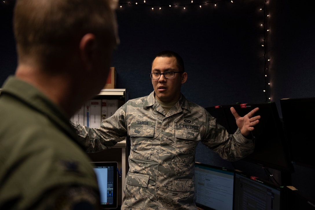 U.S. Air Force Senior Airman Alan Garcia, 325th Fighter Wing Tyndall Command Center junior emergency actions controller, briefs U.S. Col. Brain Laidlaw, 325th FW commander, on emergency action procedures at Tyndall Air Force Base, Florida, Jan. 24, 2020. Garcia  and his team receive, process, and disseminate emergency action, anti-terrorism, and force protection messages. (U.S. Air Force photo by Staff Sgt. Magen M. Reeves)