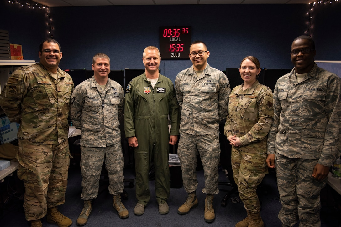 U.S. Air Force Col. Brain Laidlaw, 325th Fighter Wing commander, center, poses for a photo with members of the Tyndall Command Center at Tyndall Air Force Base, Florida, Jan. 24, 2020. The Tyndall Command Center is the command and control focal point for the wing commander and base agencies during wartime, contingency, emergency management operations and natural disasters. (U.S. Air Force photo by Staff Sgt. Magen M. Reeves)