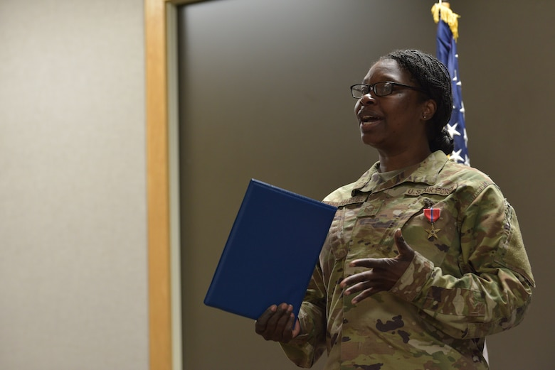 Master Sgt. Racquel Farquharson, 45th  Comptroller Squadron financial operations flight chief, speaks to 45th CPTS Airmen after recieving the Bronze Star Medal, January 10, 2020 at Patrick Air Force Base, Fla. During her deployment, she alternated between Al Udied Air Base, Qatar, and Bagram Airfield, Afghanistan. (U.S. Air Force photo by Senior Airman Dalton Williams)