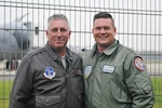 U.S. Air Force Lt. Col. Troy Smith poses with German Air Force Capt. Wolf-Soren Radke Nov. 19, 2019, at NATO Air Base Geilenkirchen. Smith and Radke are continuing a friendship their fathers, who were also military members, started years ago.