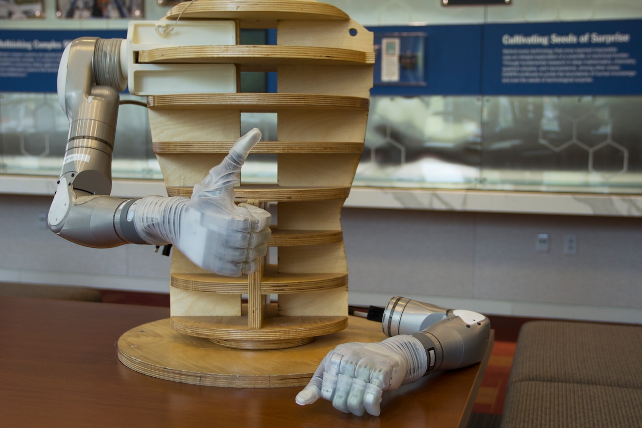 The Life Under Kinetic Evolution (LUKE) Arm™ is displayed attached to a wooden torso.