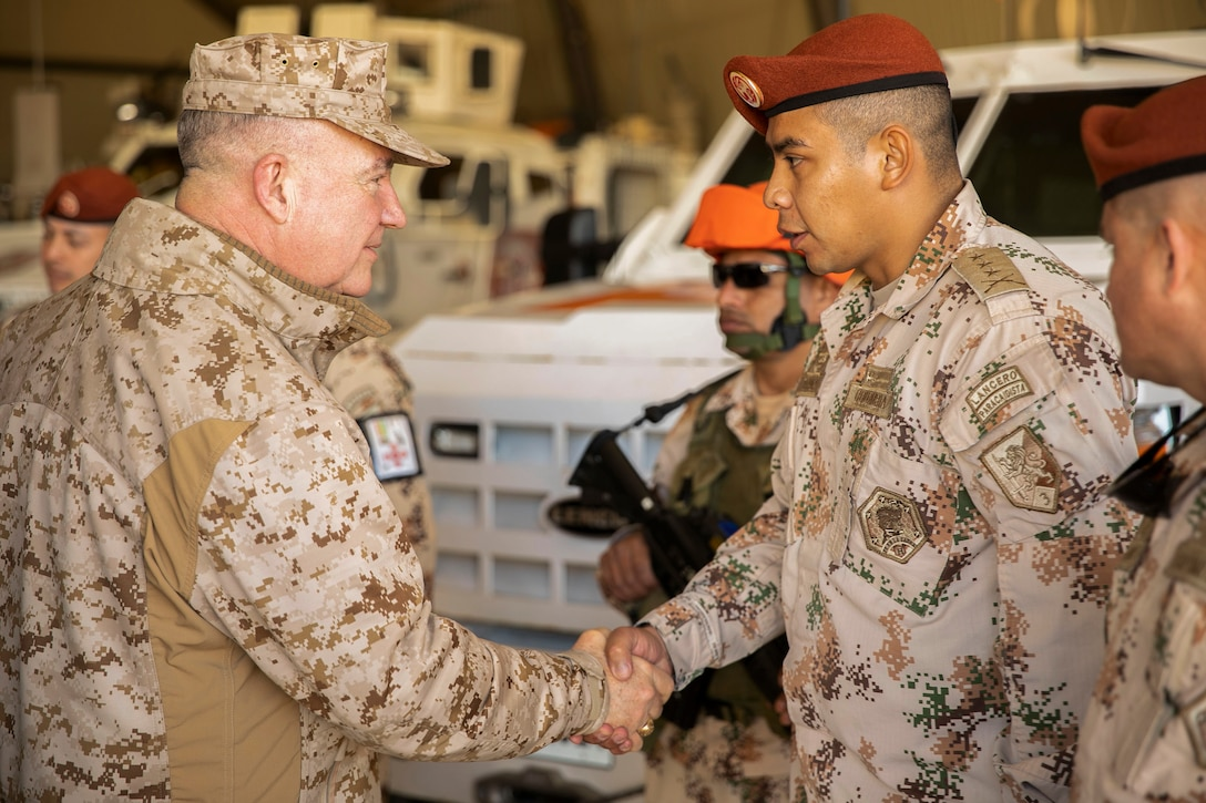 U.S. Marine Corps Gen. Kenneth F. McKenzie Jr., the commander of U.S. Central Command, left, shakes hands with a Columbian Army soldier at Forward Operating Base (FOB) North, Egypt, Jan. 26, 2020. (U.S. Marine Corps photo by Sgt. Roderick Jacquote)