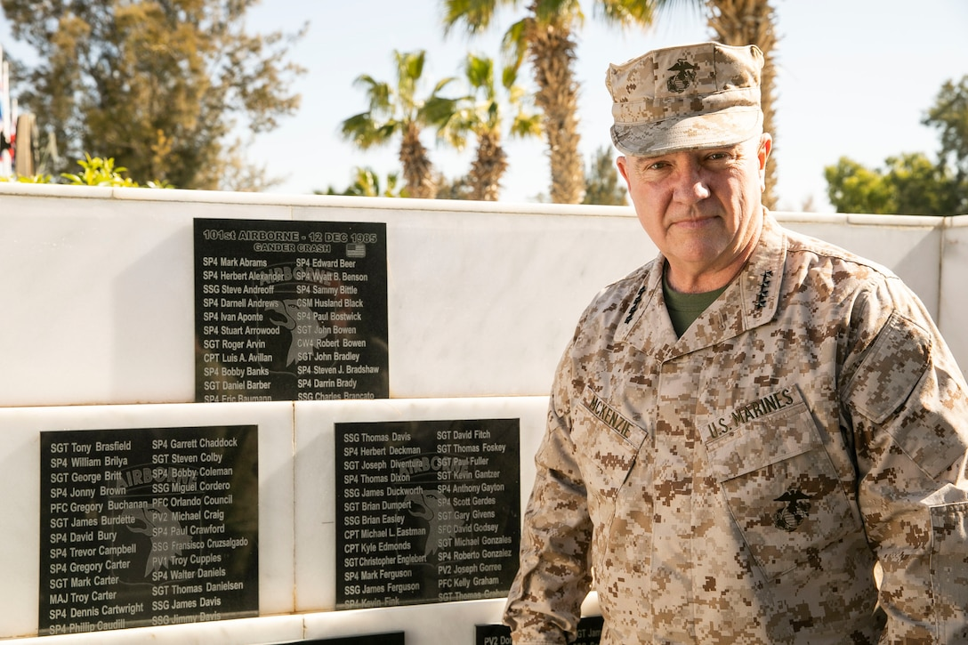 U.S. Marine Corps Gen. Kenneth F. McKenzie Jr., the commander of U.S. Central Command, poses for a photo next to the 101st Airborne Gander Crash Memorial at Forward Operating Base (FOB) North, Egypt, Jan. 26, 2020. (U.S. Marine Corps photo by Sgt. Roderick Jacquote)