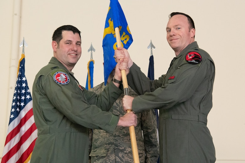 Military officer receives guidon flag