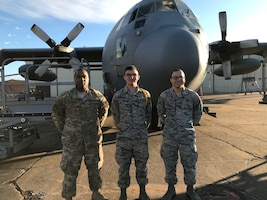Airman Joshua Olesen, 365th Training Squadron instrument flight control systems apprentice course graduate, center, poses in front of a C-130 Hercules at Sheppard Air Force Base, Texas. (Courtesy photo)