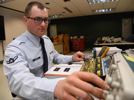 U.S. Air Force Airman Blanford Boston, 338th Training Squadron student, tests amplitude modulation circuits during the Cyber Space Support Common Course inside Dolan Hall at Keesler Air Force Base, Mississippi, Jan. 27, 2020. Boston graduated with perfect scores throughout the course. He will continue his follow-on training in the radio frequency transmission systems course at Keesler AFB. (U.S. Air Force photo by Kemberly Groue)