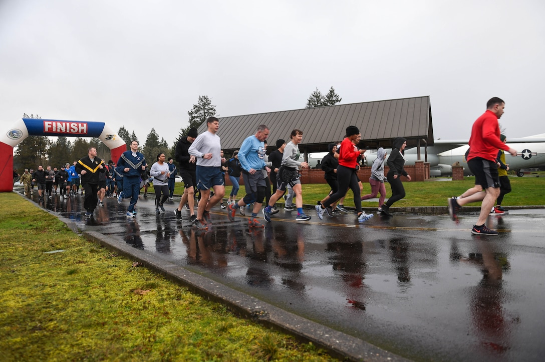 Airmen, Soldiers, and family members begin the 5K run held for Martin Luther King Jr. Day obervance at Heritage Hill on Joint Base Lewis-McChord, Wash., Jan. 24, 2020. The observance events held for Martin Luther King Jr. Day was intended to reflect on the meaning of the holiday and Martin Luther King Jr.'s influence and relevance. (U.S. Air Force photo by Airman 1st Class Mikayla Heineck)