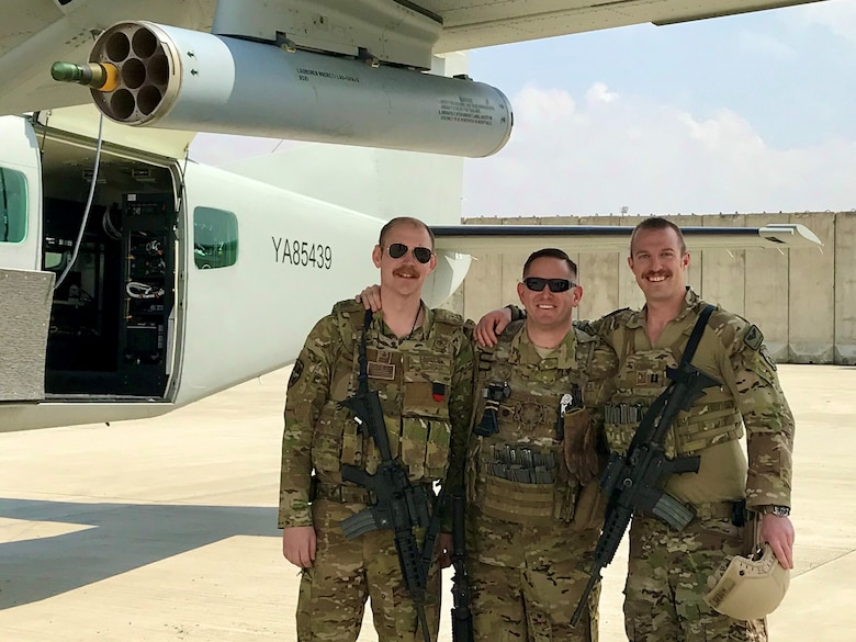 U.S. Air Force Lt. Col. Carl Miller (center), 538th Air Expeditionary Advisory Squadron commander, with U.S. Air Force Capt. Adam Ediger (left) and Capt. Charlie Hobbs at Hamid Karzai International Airport in Kabul, Afghanistan in May 2019. Miller was named a 2019 Lance P. Sijan United States Air Force Leadership Award winner in the senior officer category. (Courtesy Photo)