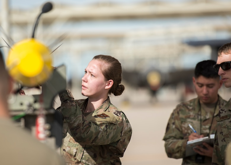 Airman 1st Class Amanda Knutson, 63rd Aircraft Maintenance Unit weapons load crew member, prepares an inert munition for loading onto an F-35A Lightning II during the Annual Load Crew Competition, Jan. 24, 2020, at Luke Air Force Base, Ariz.