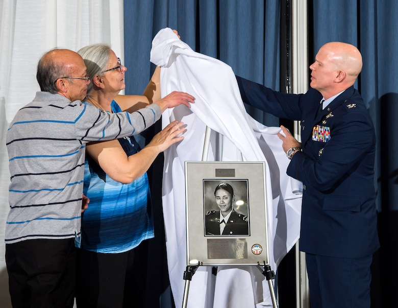 "Michelle and Larry Castro help Col. Timothy Thurston unveil the U.S. Air Force Academy Preparatory School's 2020 Exemplar in honor of the late Capt. Victoria A. ""Tori"" Pinckney in the Falcon Club at the U.S. Air Force Academy, Colo., Jan. 24, 2020. Cadet candidates selected Pinckney because she was a leader of the people and always valued service before self. The Castros are Pinckney's parents and Thurston serves as the Prep School commander. (U.S. Air Force photo by Trevor Cokley)"
