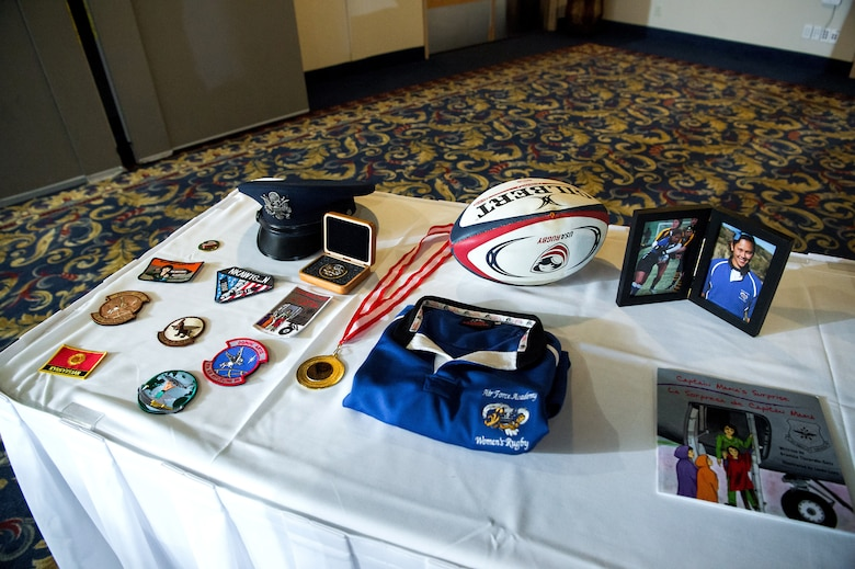 "Cadet candidates with the U.S. Air Force Academy Preparatory School display mementos from the late Capt. Victoria A. ""Tori"" Pinckney's life during the 2020 Exemplar Dinner honoring her in the Falcon Club at the U.S. Air Force Academy, Colo., Jan. 24, 2020. Pinckney was a 2008 Academy graduate and played on the Women's Rugby team during her tenure with Cadet Squadron 15 in Vandenberg Hall. (U.S. Air Force photo by Trevor Cokley)"