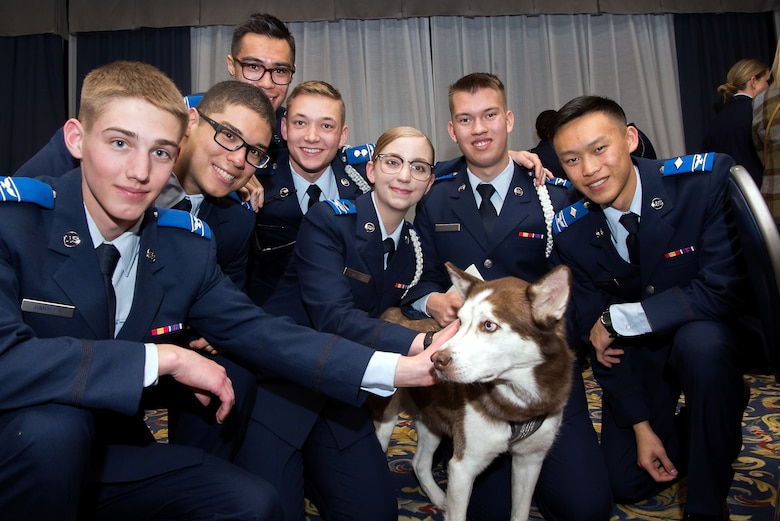 "U.S. Air Force Academy Preparatory School cadet candidates pose with a husky they named ""Tori"" in honor of the late Capt. Victoria A. Pinckney, who they named as their 2020 Exemplar, in the Falcon Club at the U.S. Air Force Academy, Colo., Jan. 24, 2020. The Prep School's mascot is a husky. Pinckney was a 2008 Academy graduate. (U.S. Air Force photo by Trevor Cokley)"