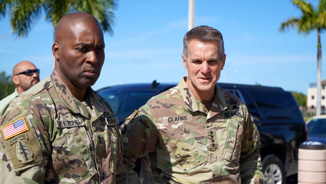 Two generals pay respects at memorial.