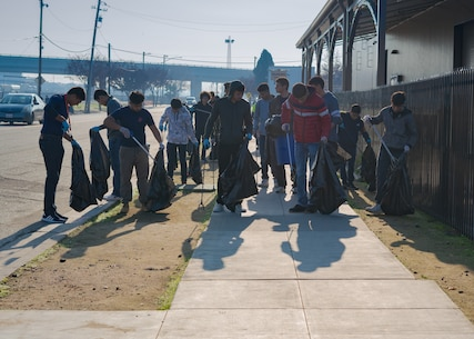 Poolees with U.S. Marine Corps Recruiting Substation Fresno, Recruiting Station Sacramento, pick up trash while volunteering at the Fresno Rescue Mission in Fresno, Calif., Jan. 11, 2020. Part of the Marine Corps mission is to return quality citizens to society and this was an opportunity to give back to the community.