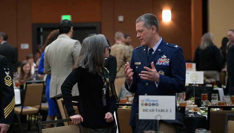 Col. Aras Suziedelis, National Security Agency-Colorado deputy director, speaks with Andrea Grayson, an event attendee, during the annual State of the Base luncheon at the Radisson Hotel in Aurora, Co., Jan. 22, 2020.