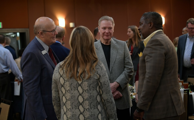 Local community and military members mingle prior to the start of the annual State of the Base luncheon at the Radisson Hotel in Aurora, Co., on Jan. 22, 2020.