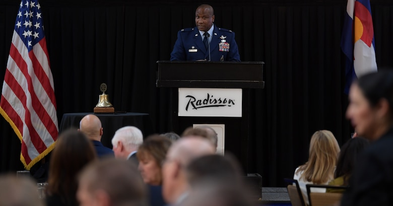 Col. Devin Pepper, 460th Space Wing commander, addresses over 250 members from the local community during the annual State of the Base luncheon at the Radisson Hotel in Aurora, Co., on Jan. 22, 2020
