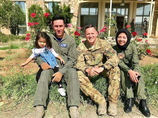 U.S. Air Force Lt. Col. Carl Miller (center), 538th Air Expeditionary Advisory Squadron commander, with married Afghan air force pilots at Hamid Karzai International Airport in Kabul, Afghanistan in May 2019. Miller was named a 2019 Lance P. Sijan United States Air Force Leadership Award winner in the senior officer category. (Courtesy Photo)
