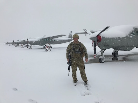 U.S. Air Force Lt. Col. Carl Miller, 538th Air Expeditionary Advisory Squadron commander, stands next to Afghan air force C-208 Caravans on the flightline at Hamid Karzai International Airport in Kabul, Afghanistan in January 2019.  While deployed, Miller advised the entire AAF Kabul Wing operations group, including six major weapons systems, 86 aircraft, six squadrons and 201 aircrew members, helping earn him a 2019 Air Force Lance P. Sijan Leadership Award. (Courtesy Photo)