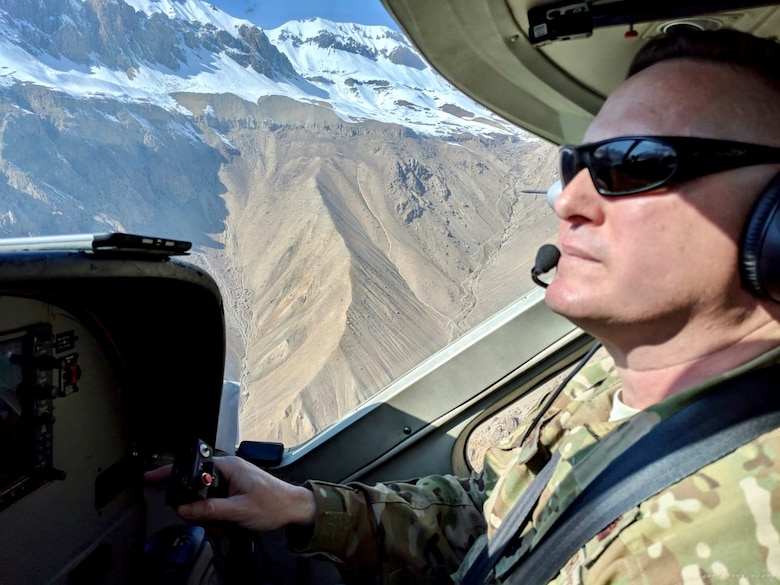 U.S. Air Force Lt. Col. Carl Miller, 538th Air Expeditionary Advisory Squadron commander, flies a C-208 Caravan over northern Afghanistan in this undated photo. Miller was named a 2019 Lance P. Sijan United States Air Force Leadership Award winner in the senior officer category. (Courtesy Photo)