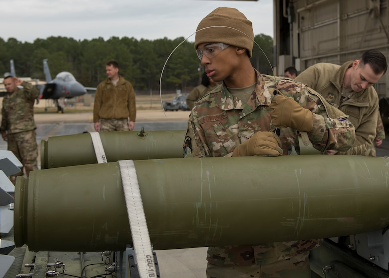 Airman 1st Class Jaden Edwards, 4th Munitions Squadron precision guided munitions technician, assembles munitions during a quarterly Load Crew Competition.