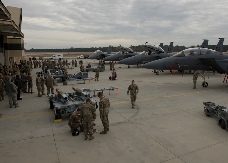 Airmen from the 4th Maintenance Group compete in a quarterly Load Crew Competition
