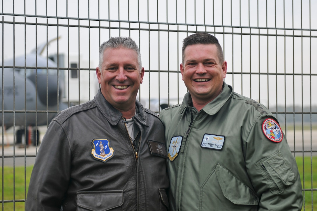 U.S. Air Force Lt. Col. Troy Smith poses with German Air Force Capt. Wolf-Soren Radke Nov. 19, 2019, at NATO Air Base Geilenkirchen. Smith and Radke are continuing a friendship their fathers, who were also military members, started years ago. (U.S. Air National Guard photo by Senior Airman Christi Richter)