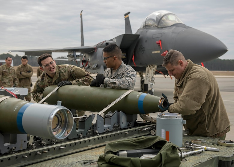 Airmen from the 4th Munitions Squadron assemble munitions during a quarterly Load Crew Competition.