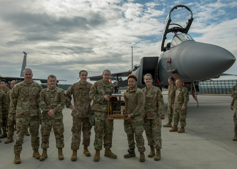 Airmen from the 333rd Aircraft Maintenance Unit receive a trophy after winning a quarterly Load Crew Competition.