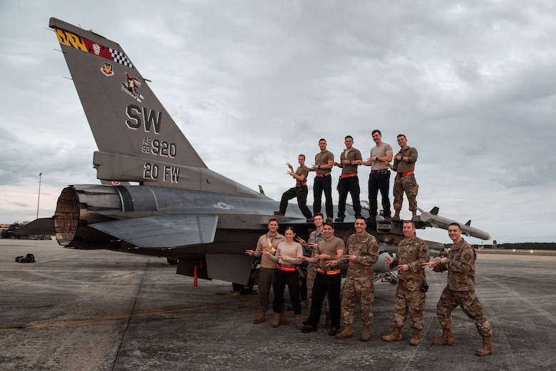 A photo of maintainers posing with their unit signature hand gesture.