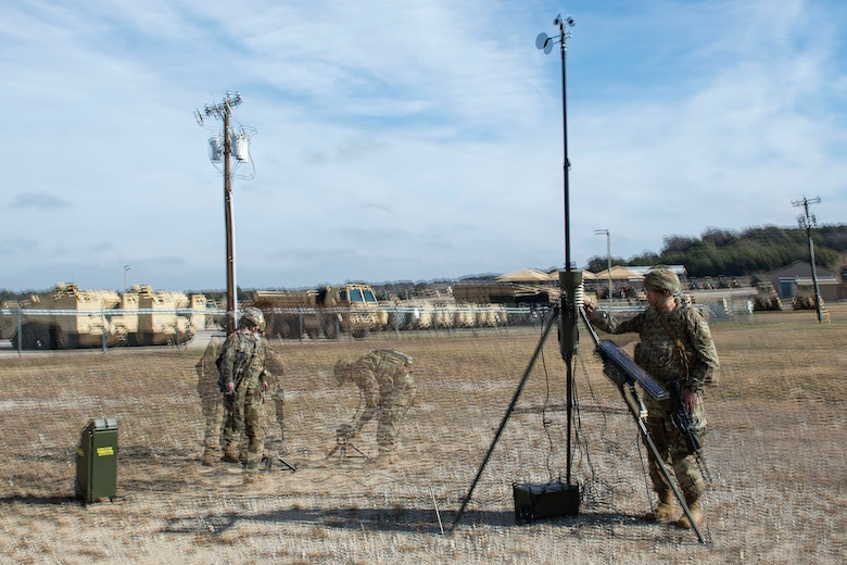 Photo of Airmen assigned to the 3d Weather Squadron set up a tactical meteorological observation system during a certification field exercise.