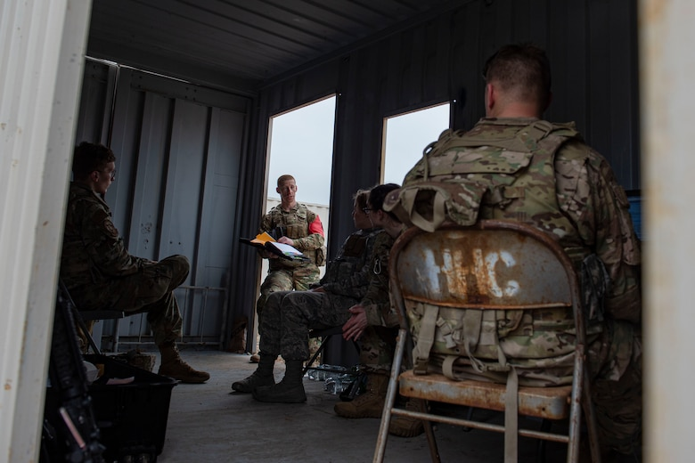 Photo of Airmen assigned to the 3d Weather Squadron debrief after a certification field exercise.