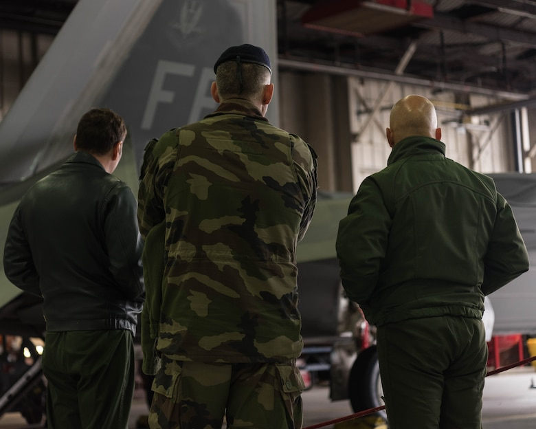 French delegates from the NATO – Allied Command Transformation view a U.S. Air Force F-22 Raptor during a visit to Joint Base Langley-Eustis, Virginia, Jan. 24, 2020. During their visit, French delegates were able to walk around the F-22 and learn about the 1st Fighter Wing's rich history. (U.S. Air Force photo by Airman 1st Class Marcus M. Bullock)