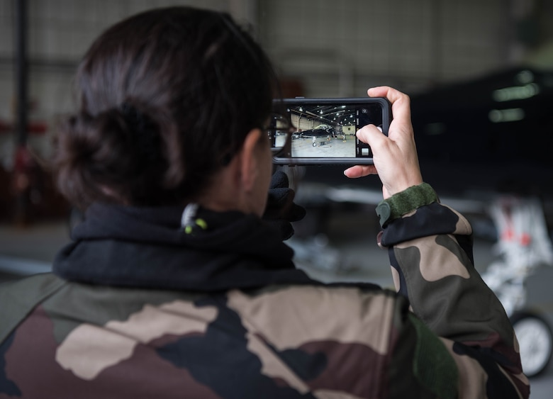 A French delegate snaps a photo of a U.S. Air Force T-38 Talon during a visit to Joint Base Langley-Eustis, Virginia, Jan. 24, 2020. The delegates were able to get up-close and personal with the aircraft and even look into the cockpit of the T-38. (U.S. Air Force photo by Airman 1st Class Marcus M. Bullock)