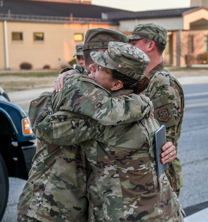 Chief Master Sgt. Michael Pelletier, 618th Air Operations Center command chief, and Chief Master Sgt. Shae Gee, 436th Airlift Wing command chief, greet each other Jan. 24, 2020, at Dover Air Force Base, Del. Gee was excited to see an old friend, Pelletier. (U.S. Air Force photo by Senior Airman Christopher Quail)