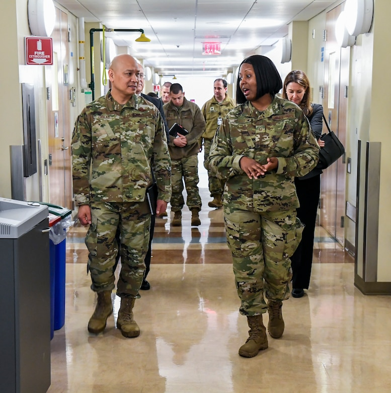 Master Sgt. Iesha Stanley (right), Armed Forces Medical Examiner System (AFMES) flight chief of forensic toxicology, speaks to Brig. Gen. Jimmy Canlas, 618th Air Operations Center commander, Jan. 24, 2020, at Dover Air Force Base, Del. Canlas visited AFMES to learn more about their forensic investigative services, to include forensic pathology, DNA forensics, forensic toxicology and medical mortality surveillance. (U.S. Air Force photo by Senior Airman Christopher Quail)