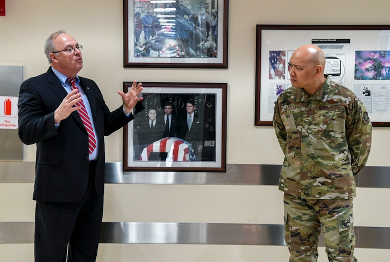 Mark Vojtecky, Armed Forces Medical Examiner System (AFMES) chief of staff, briefs Brig. Gen. Jimmy Canlas, 618th Air Operations Center commander, Jan. 24, 2020, at Dover Air Force Base, Del. Canlas visited AFMES to learn more about their forensic investigative services, including forensic pathology, DNA forensics, forensic toxicology and medical mortality surveillance. (U.S. Air Force photo by Senior Airman Christopher Quail)